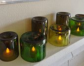 Tea Light Candle Holders Hurricane Lamps Lanterns Centerpiece made from Upcycled Wine Bottles Large Quantities Available. $32.00, via Etsy.