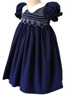 What a pretty classic look we have here, our beautiful Bliss girls dress features a white Peter Pan collar with crispy clean lines that makes it an instant favorite. The hand smocked is completely don