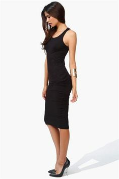 Black shift dress, or would work well as a layering piece to add some warmth to light weight maxis