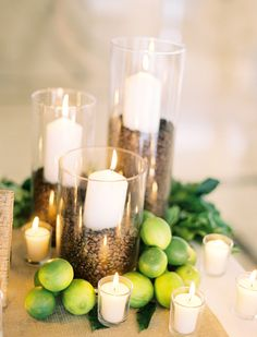 Espresso beans, limes, and white pillar candles. Photo: Jose Villa. Event Planner, Floral Designer: Aimee Monihan of Tropical Occasions