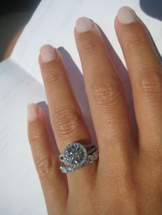 the center is 2.50 and and the halo/split shank add another .8 carats.  for reference, finger is 6.25