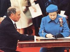 Queen Elizabeth signing the Canadian constitution with Pierre Trudeau the prime minister at the time for Canada, this was a true patriotic act for Canada and with our new independent nation can go to our own wars have our own trades but are not fully gone from the British influence like our coins and military names like Queens Own Rifles Regiment
