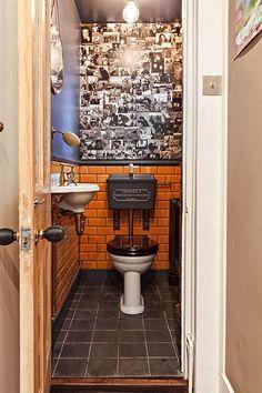 Thomas Crapper toilet under stairs retro aesthetic. Brick tiled ?white