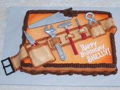 "Tool Belt Cake The ""tools"" are chocolate and the ""tool belt"" is fondant. I airbrushed ""Home Depot"" orange."