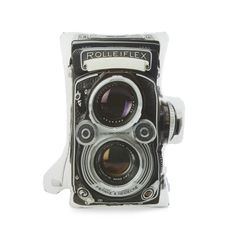 Vintage fiends and photography buffs will love the cotton sateen Rollei Pillow. Featuring the image and shape of a vintage Rolleiflex camera, the pillow takes couch art to a whole new level.  Find the Rollei Pillow, as seen in the Mid-Century Modern Ski Trip Collection at http://dotandbo.com/collections/mid-century-modern-ski-trip?utm_source=pinterest&utm_medium=organic&db_sku=ITS0001