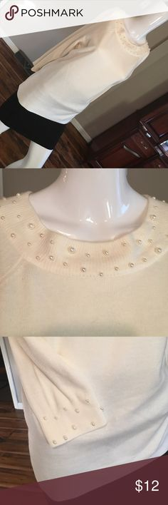 Sag harbor sweater Winter white sweater w pearl detail around the neck and bottom of the sleeves. NWOT size small, beautiful sweater, just a bit to small on me ... sagharbor Tops