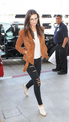 Try a suede moto jacket with a white tee and ripped skinnies as Emily Ratajkowski did.