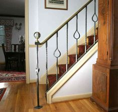 Sculptor : Custom Designed Stair Railing : Hand Forged Steel and Naval Brass