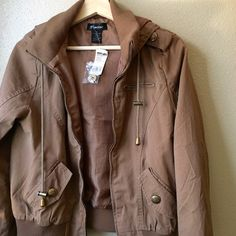 Taupe Military Style Zip Jacket Taupe/light brown military style zip jacket with hood and faux pockets. Brand new with tag. Never worn. Jackets & Coats Utility Jackets