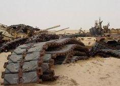 Gloomy tank graveyards hold the rusting bones of war