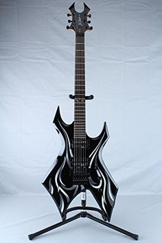 B.C. Rich KKW2TO Kerry King Warlock Two Electric Guitar, Tribal Onyx Reviews $ 328.55 Electric Guitars Product Features Construction Bolt On Material Basswood Fret board Rosewood Bridge Type Licensed Floyd Rose Tremolo Electronics Master Volume, Master Tone, 3-Way Toggle Neck Pickup B.D.S.M. Humbucker Bridge Pickup B.D.S.M. Humbucker .. http://www.guitarhomes.com/b-c-rich-kkw2to-kerry-king-warlock-two-electric-guitar-tribal-onyx-reviews/