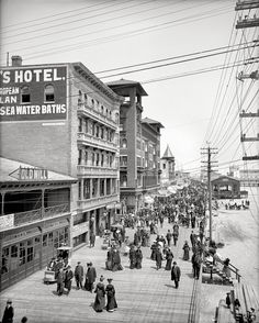 Circa 1905. Boardwalk, Atlantic City. Strollers on parade, at least one beach baby, and a number of ponies.