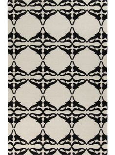 This Frontier Collection rug (FT-466) is manufactured by Surya. Frontier collection features a series of flat-weave reversible designs with tribal and casual themes.