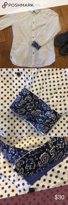 ✨ EXPRESS GORGEOUS MEN'S DRESS SHIRT ✨ BNWOT, never worn, bought for wedding but didn't wear it. This shirt has great designs and color. Navy blue tiny flowers or circular shapes with contrasting paisley cuffs and collar (see photos) even the buttons are pretty. Slim Fit Would look nice with dress pants but also with a nice pair of jeans and flip flops. Your Man would be a stud wearing this shirt!! 16-161/4 collar. Using last two photos as an example of shirt if bought new from online. 🤗…