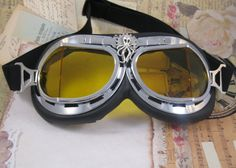 Steampunk Octopus and Gear Aviator Goggles - Royal Air Force Style with Chrome Rims and Yellow Lenses. $20.00, via Etsy.