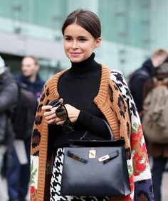 How To Wear Cardigans - Street Style Inspiration | Street style photos that prove the cardigan doesn't have to be boring. #refinery29 http://www.refinery29.com/how-to-wear-cardigans-street-style-pictures