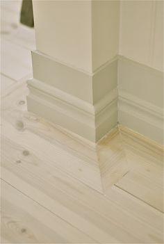 Whitewashed pine floor and beautiful grey molding