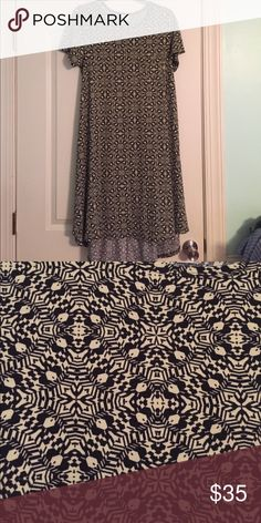 Carly Cream background with black print. Worn once! Such a comfy dress and such a fun pattern. LuLaRoe Dresses