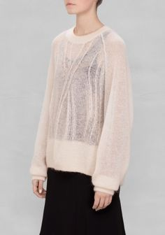 Made from a warm mohair blend, this sweater has an elegant rib-stitch pattern.