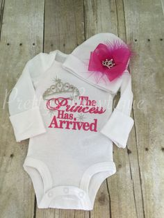"How adorable is this baby girl coming home from the hospital outfit featuring an embroidered bodysuit and hat set?! Announcing that the ""Princess"