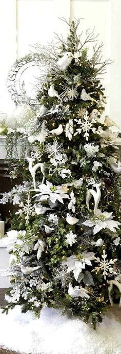 The Ultimate Christmas Tree Decorating Guide - laurel home - white on white Christmas tree. Original source unknown.