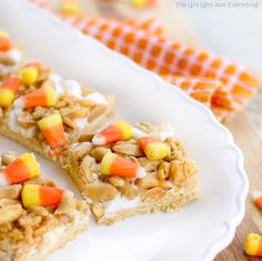 Scarecrow Treats: Crust - 1/2 cup butter (softened), 1 (18.25 ounce) yellow cake mix, 1 large egg, 3 cups mini-marshmallows. Topping - 1/2 cup light corn syrup, 1/4 cup packed brown sugar, 1/4 white sugar, 1/2 cup creamy peanut butter, 2 teaspoons vanilla, 2 cups Rice Crispies cereal, 2 cup salted peanuts, 1 cup candy corn