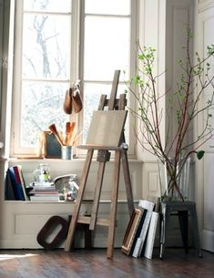 Just what my artist's corner will be/potentially look like - small corner space in the office. Clean with a simple easel to work with.