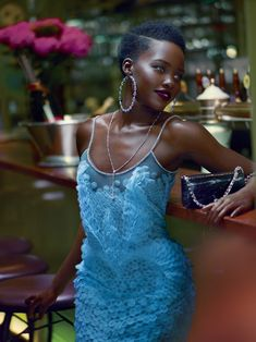 Blue Belle - Nyong'o stars in December's Star Wars: The Force Awakens as a pirate named Maz Kanata. Givenchy by Riccardo Tisci Haute Couture lace dress, earrings, and bag. Tiffany & Co. necklace.  Photographed at Bouillon Racine Fashion Editor: Tonne Goodman