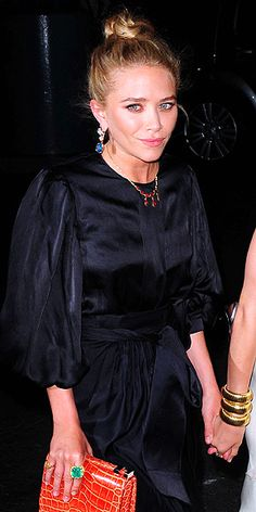 Cocktail rings are an easy way to inject some drama and luxe appeal into an otherwise simple outfit, as Mary-Kate Olsen proves with the emerald-hued sparkler on her pointer finger.