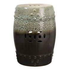 Ceramic garden stool with cut-out detailing.    Product: Garden stoolConstruction Material: CeramicColor: MultiFeatures:  Cut out detailsAdds seating and dcor to your gardenCharming design Dimensions: 19.75 H x 15 Diameter