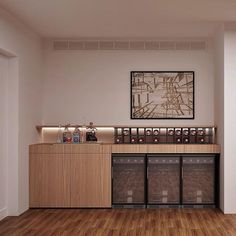 Um aparador pode ter muitas funções, aqui acolhe as adegas refrigeradas e ainda recebe um grid metálico para as garrafas. Projeto #sala2arquitetura