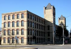 This building was the first silk mill in Belding. It was built by the Belding Brothers in 1886 and then immediately sold. Belding Bros & Co reacquired in 1907. Like all of the silk mills in Belding it was closed by 1932. I'm not sure what it did for the next 50 years, but in 1986 it was redeveloped into the Silk Mill Apartments. Today it's called Flats on the River.