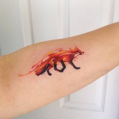 Watercolor style fox tattoo on the left forearm. Tattoo artist:...