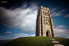 Glastonbury Tor in Somerset, England. This tower ruin is all that remains of the medieval church that stood at the top of this tall hill until the year 1275. Steeped in myth and legend, this site also plays a part in the quest for the Dragon Chalice.