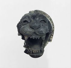 NEO-ASSYRIAN, HEAD OF A ROARING LION: ca. 9th–8th century B.C., mesopotamia.
