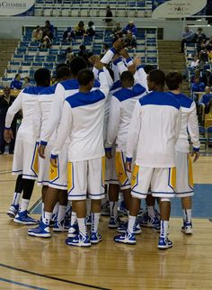 The Cowboys huddle up before the tipoff.