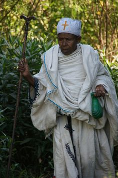 A pilgrim heads towards the monastery of Debre Maryam in the Lake Tana region, Ethiopia. Horn Of Africa, Addis Ababa, 1st Century, African Countries, Nun, East Africa, Sierra Leone, Meeting New People, Book Crafts