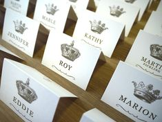 Crown escort cards - for a Royal themed wedding http://www.toptableplanner.com/blog/a-wedding-table-plan-fit-for-a-king-and-queen