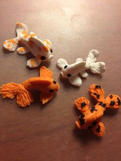 Hey, I found this really awesome Etsy listing at http://www.etsy.com/listing/156082836/koi-fish-polymer-clay-figurines-qty-1