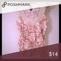 Sweet and sexy ruffled satiny tunic Size Medium vibrant colored flowers in a cream background with 4 layers of beautiful ruffles and an embroidered neckline that is absolutely stunning. In excellent condition. Maurices Tops Tunics