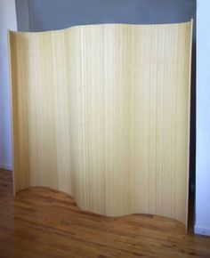 Functional bamboo wave divider screen for office partitions, privacy screens and defining a space, more finishes available standing tall Bamboo Room Divider, Room Divider Screen, Curved Walls, Wave Design, Office Decor, Curves, Wraps, It Is Finished, House Design
