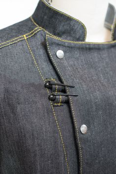 This beautiful coat is made of lightweight stretch denim. We asked and listened, and have designed a coat specifically for the working chef. We've made it longe Waiter Uniform, Cafe Apron, Chef Shirts, Hotel Uniform, Restaurant Uniforms, Denim Ideas, Fashion Project, Fashion Sketches, Custom Clothes