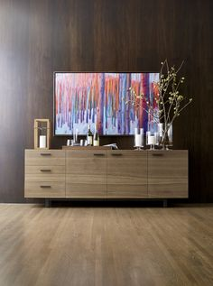 This expertly crafted sideboard reaches new heights in a clean-lined, low-profile design that emphasizes the wood's rich grain and warm color. Aspen's slim, horizontal pulls of blackened steel accent three doors and three drawers, which provide abundant storage.