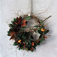 Floral designer Emily Thompson turns simple materials, like foraged branches and seedpods, into unconventional holiday wreaths that go beyond the front door.