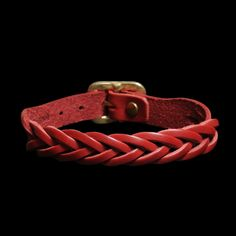 """Premium cowhide braided bracelet that will darken and develop a beautiful patina with exposure to the sun, air and daily wear. Made in Italy. -Stamped with Il Bisonte maker's mark. -Hammered buckle closure with rivet. -Features thin braid. -Total length: 9 1/4"""". -Width: 1/2""""."""