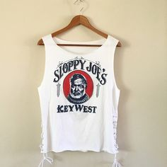 SB16 | Sloppy Joes Vintage Tank From the famous Sloppy Joes in Key West! Altered with white twill tape, silver grommets & laced down the sides. One of a kind!  BRAND: - MATERIAL: 50/50 YEAR/ERA: early 80s LABEL SIZE: - BEST FIT: S  MEASUREMENTS: Chest 18.5 inches Length 23.5 inches  *Listed as LF for views. *Price firm unless bundled.  ☠ No trades  Check out my closet for more vintage tees! LF Tops Tank Tops
