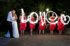 This pic looks extra fiery with the bridesmaids in red writing with sparklers : Bridal Guide blog @Mandy Dewey Seasons Bridal