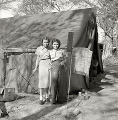 """February 1939. """"Migrant labor. Young packinghouse workers. Canal Point, Florida."""" Two of the thousands of young people who during the Great Depression found themselves picking or packing produce and living in a tent camp. Photo by Marion Post Wolcott for the Resettlement Administration."""