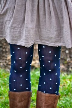 I love pairing a patterned tight with a solid color dress and cute boots. You can't go wrong!
