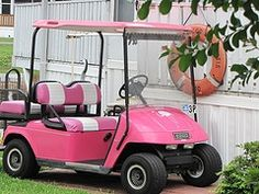 Pink golf cart!  Love it!  Since we are buying my hubby a motorcycle...this is what Im putting on my wish list. :)